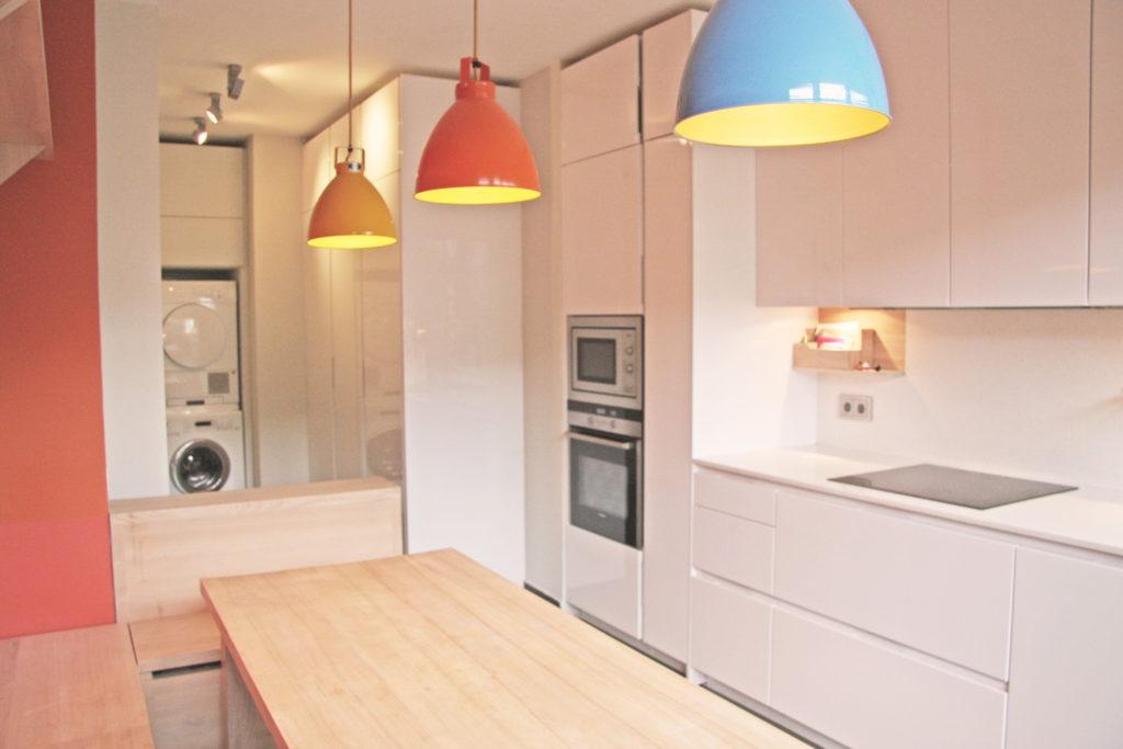 Nonjetable-Narrow-Kitchen-with-Custom-Table-and-Laundry-Area